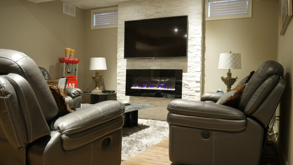 Luxury living room in basement with fire place