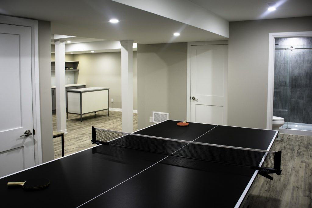 ping pong table in a finished basement