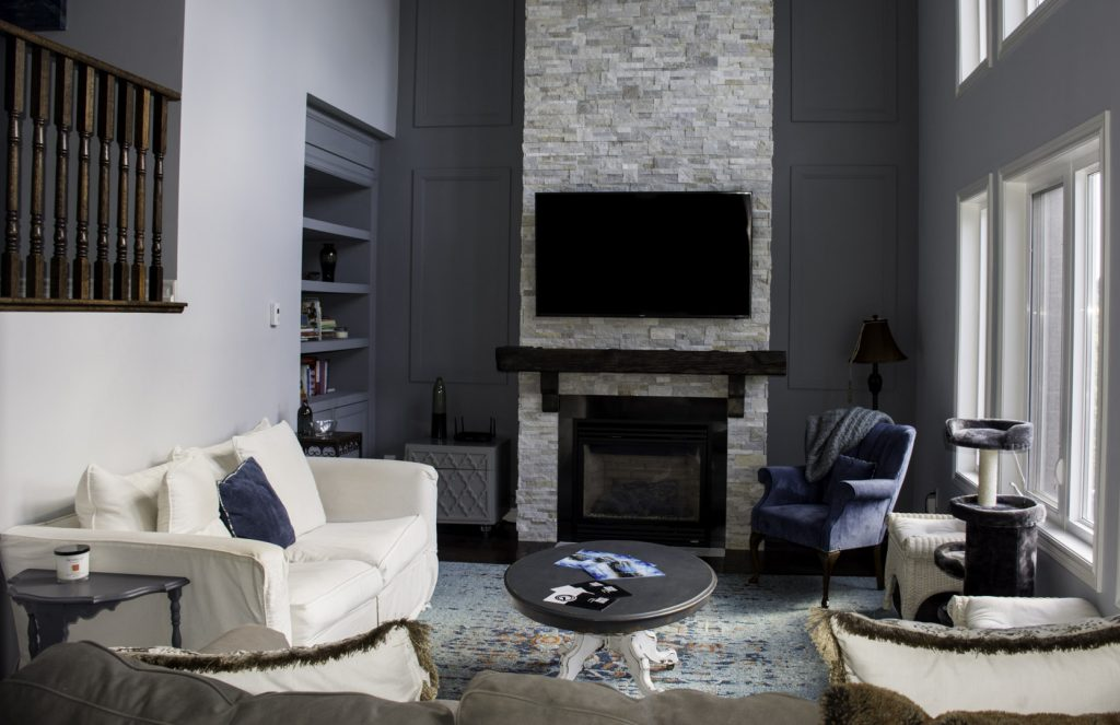 Living room-with fireplace and furniture after-renovation