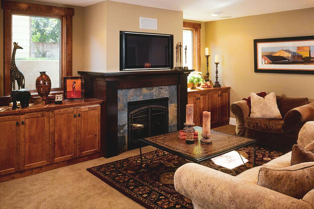 amazing basement living room with build in fireplace - basement renovations etobicoke