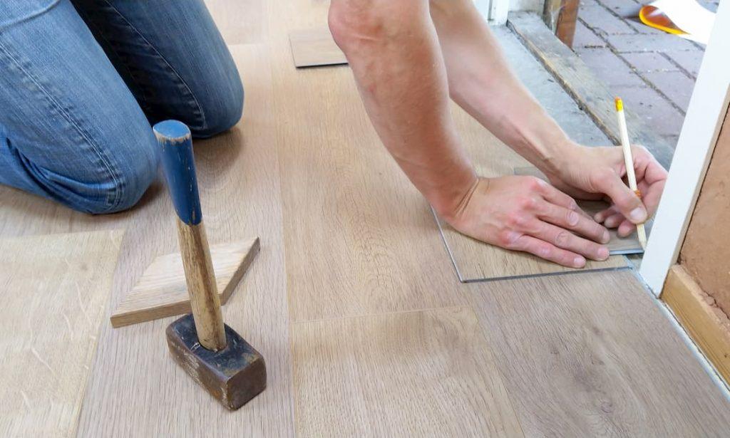 photo of a man installing basement floor insulation