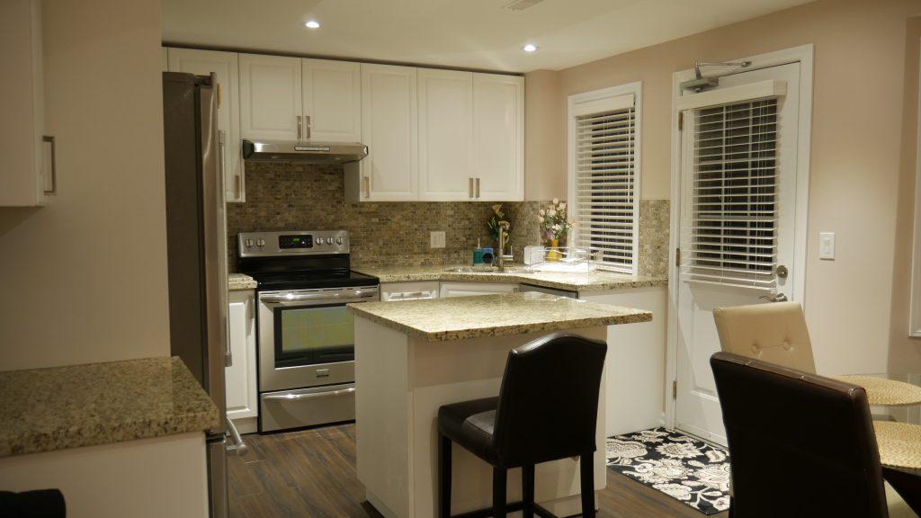 Walk out Basement with Small Kitchen - Basement Renovation Company Aurora