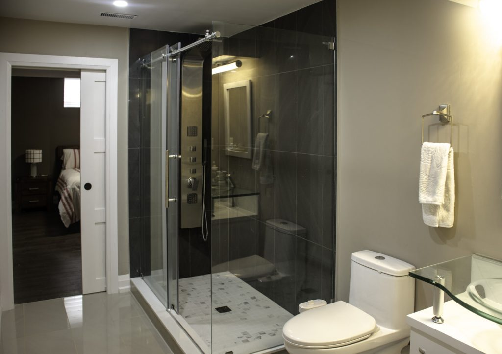 Amazing Bathroom in Custom Basement by Harmony Basements Renovation Newmarket