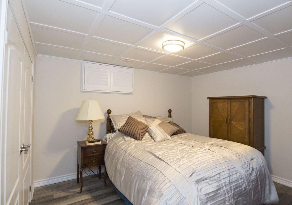 Basement Bedroom with Waffle Ceiling Design - Basement Remodeling Newmarket