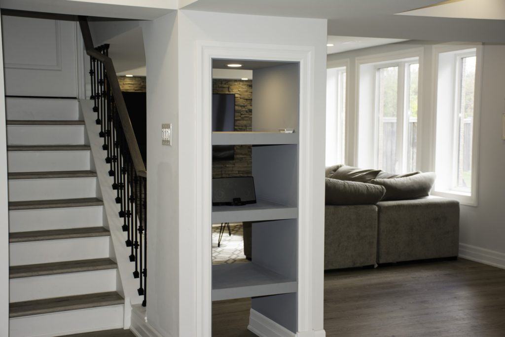 build in wall unit and luxury staircase in basement remodeling project vaughan