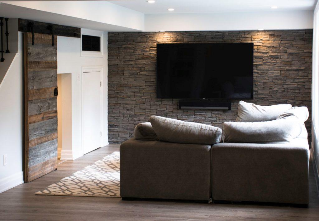 Modern Basement with Brick Wall Decor - Basement Renovation Burlington
