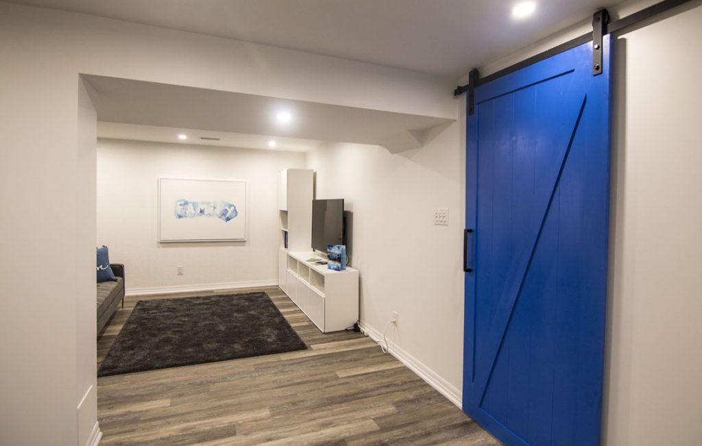 Basement Family Room with Blue Sliding Door - Basement Design Vaughan