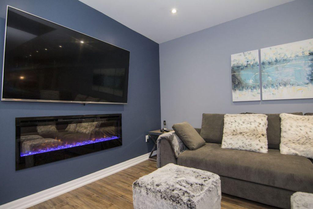 Modern Basement Family Room with Baseboard Trim - Basement Renovation Stouffville