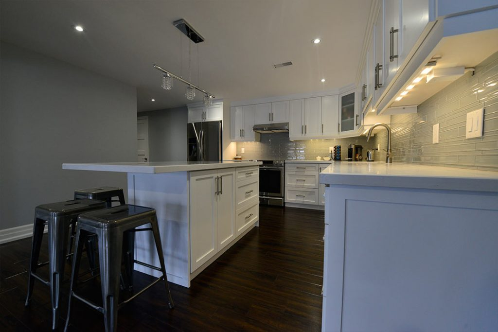 Classic Kitchen with Backlit Kitchen Cabinets - Basement Renovation Contractors Aurora