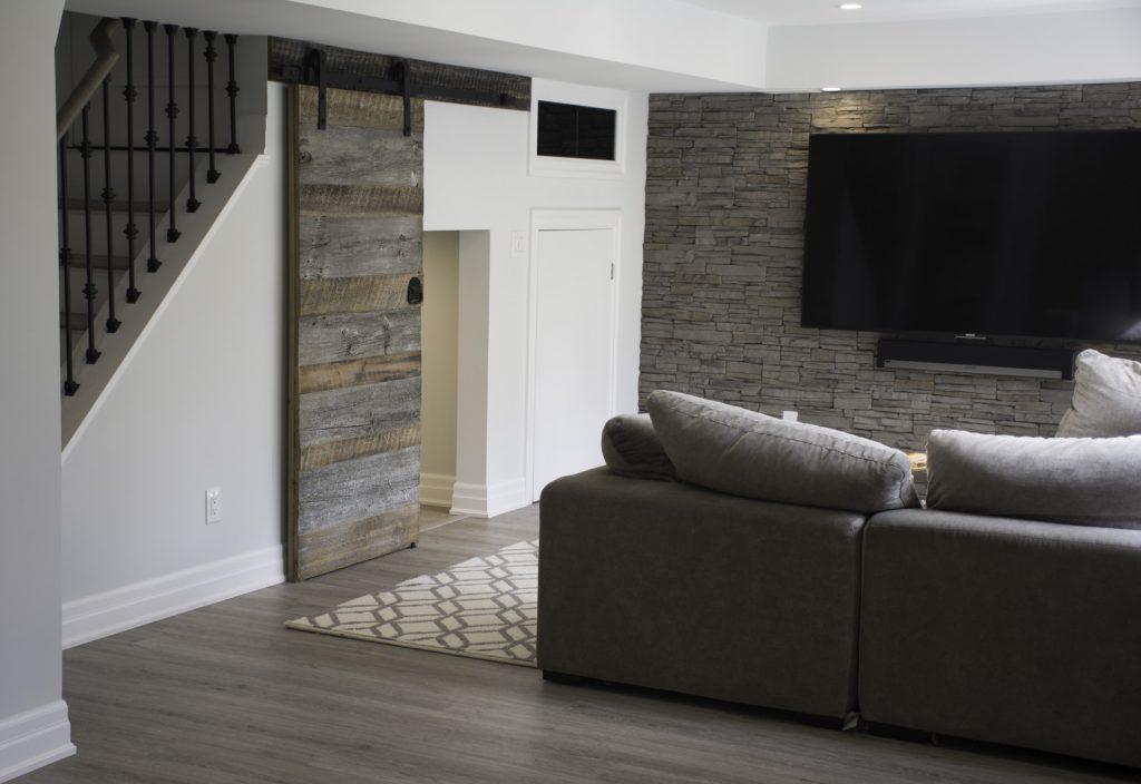 Wood Sliding Door in Custom Basement Living Room Hamilton