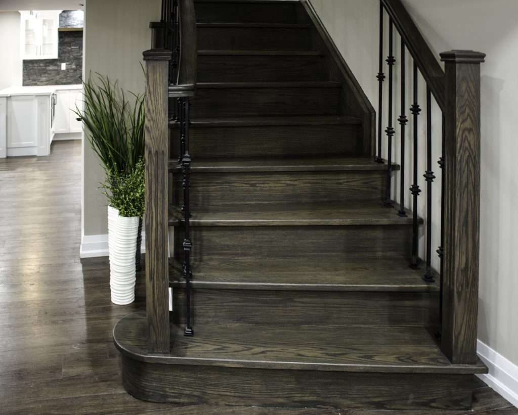 Custom Staircase with Wooden Stairs and Railing by Harmony Basements Mississauga
