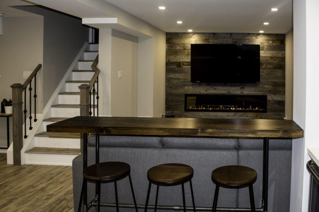 Small Bar and Family Room in Custom Basement Design Maple