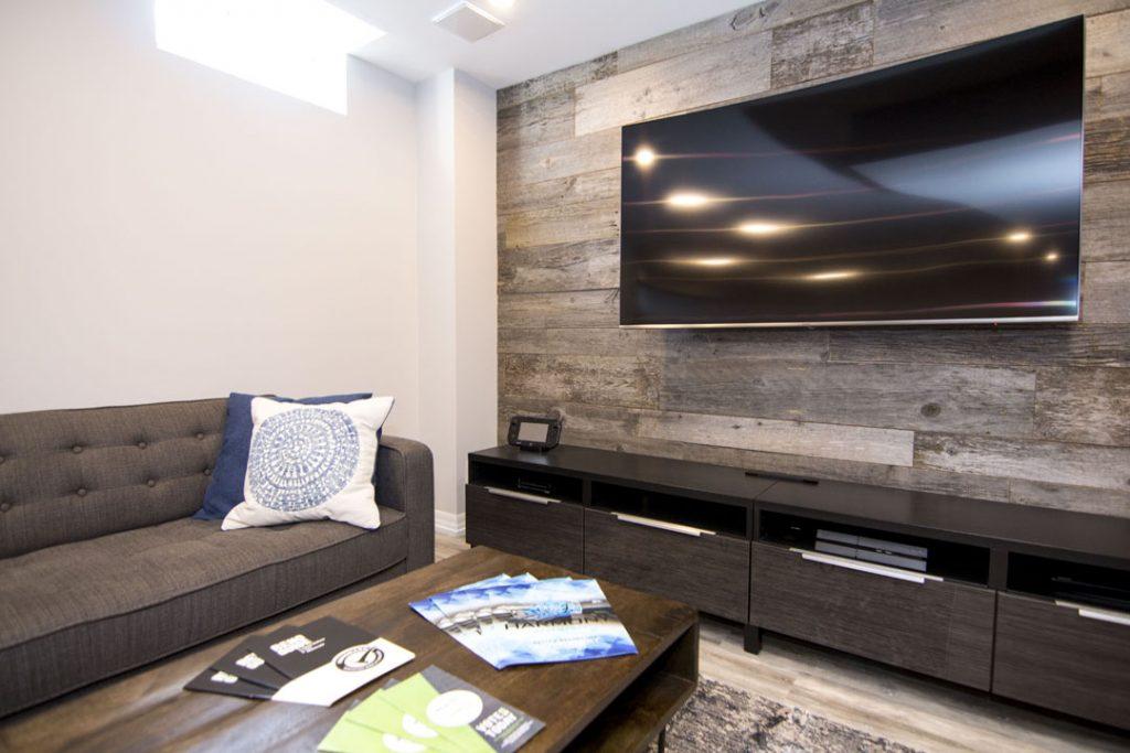 Wooden Wall Decor in Amazing Basement Family Room - Basement Finishing Stouffville