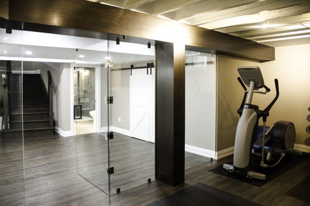 Amazing Glass Doors in Basement Gym - Basement Remodeling Vaughan