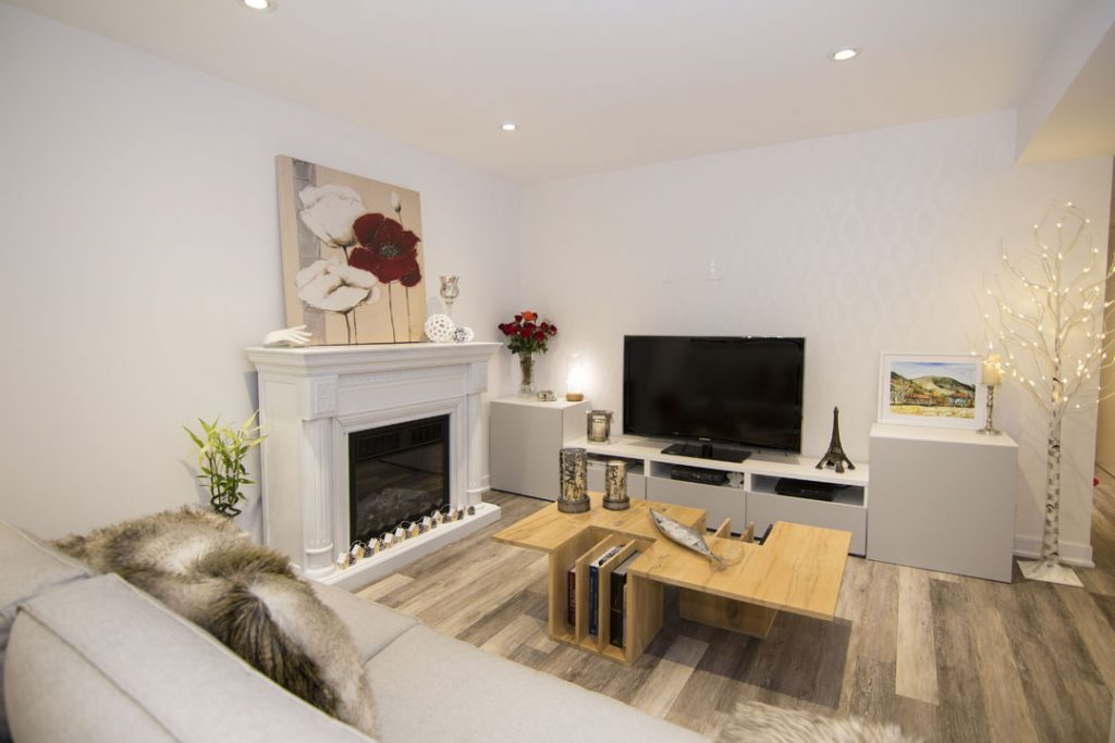 Build in Fireplace and Wall Unit in Basement Renovation Project Maple