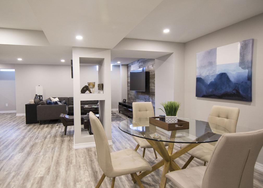 Modern Dining Room in Custom Basement by Harmony Basements Burlington
