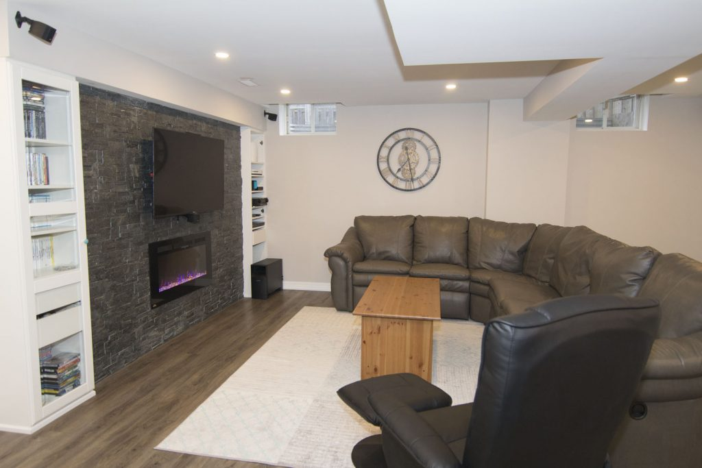 Basement Living Room with 3D Wall Decor by Harmony Basements Renovation Etobicoke