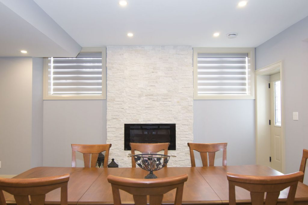 Classic Basement Dining Room with Build in Fireplace - Basement Remodeling Oshawa