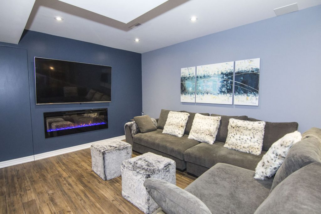 Basement Family Room with Blue Wall Painting - Basement Remodeling King City